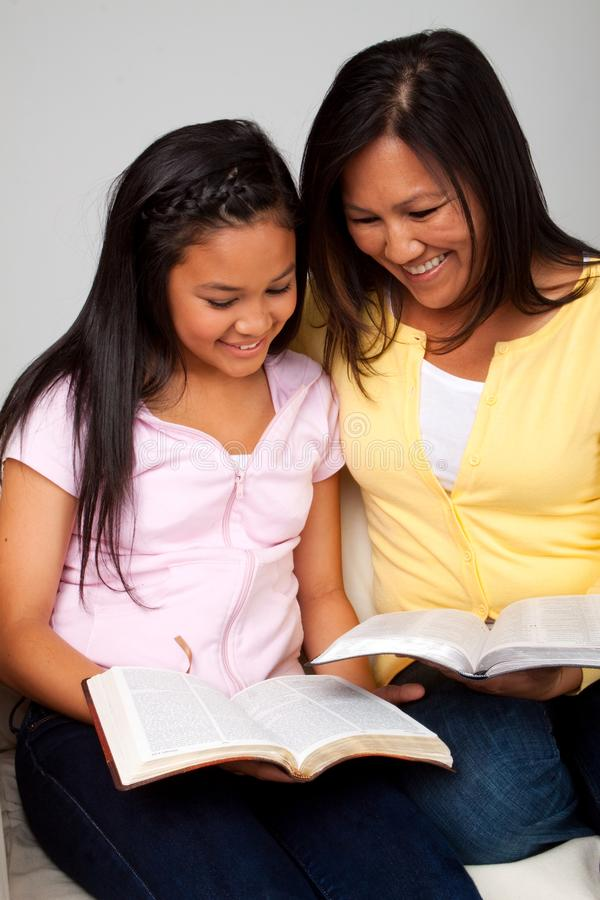 Asian mother and daughter reading and studying. royalty free stock photo