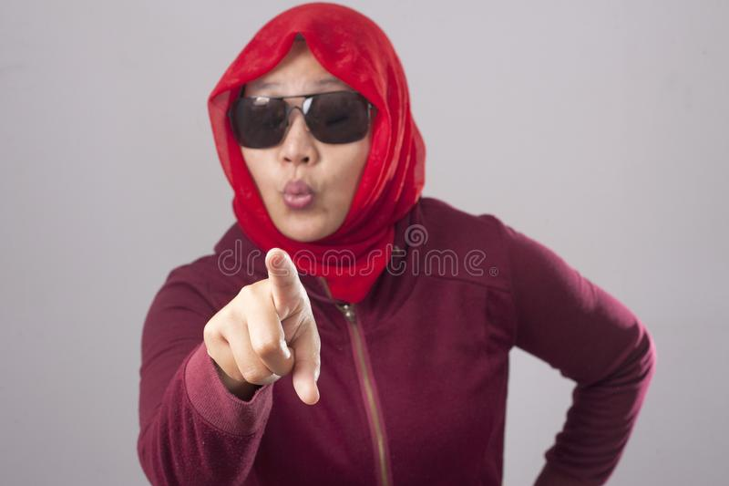 Muslim Lady in Red Pointing Forward to Camera as Choosing You Concept stock photo