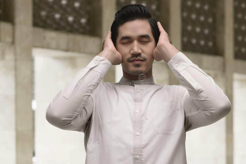 Portrait of asian muslim man praying royalty free stock photo