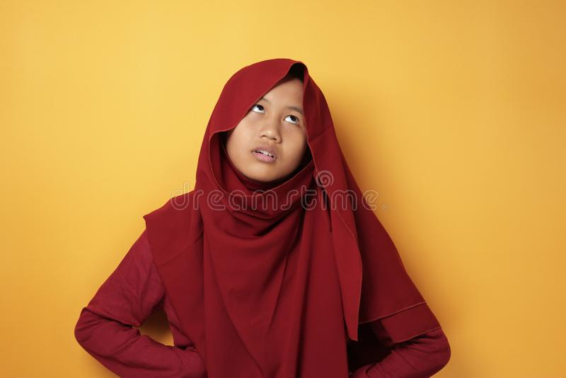 Muslim Teenage Girl Shows Annoyed Upset Expression stock photo