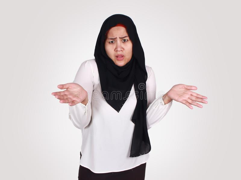 Asian Woman Shrugging Shoulder, I Don& x27;t Know Gesture royalty free stock photography