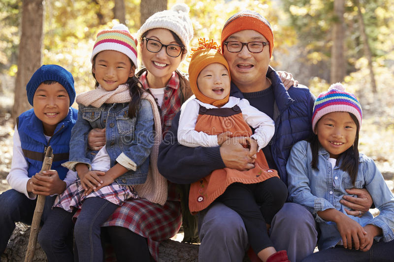 Portrait of Asian parents and four kids in a forest stock images