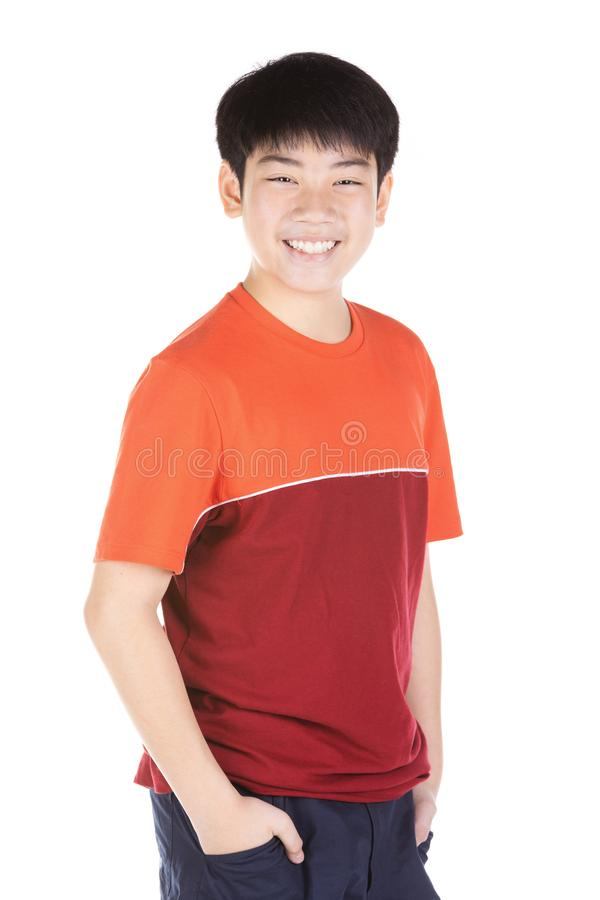 Portrait of asian smiling teen boy. Medium shot of handsome guy royalty free stock photography