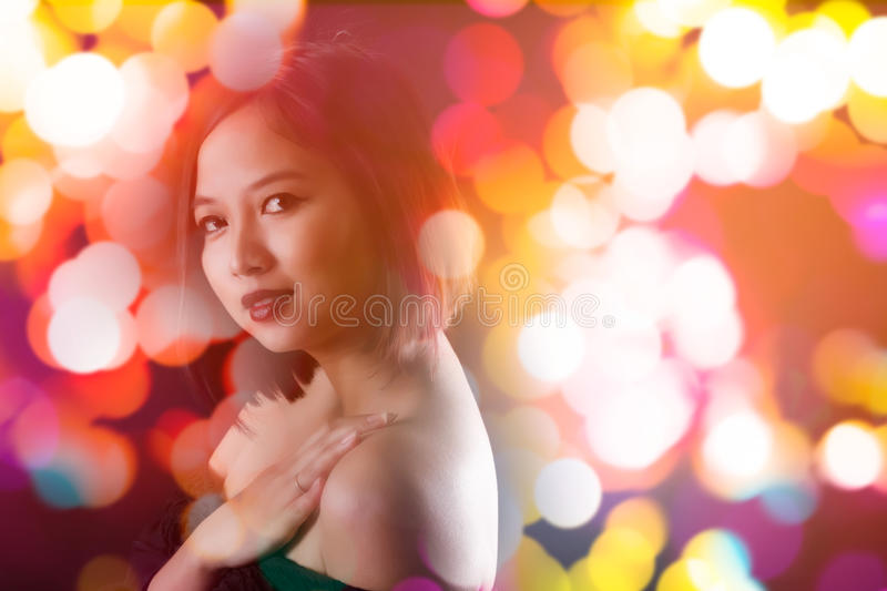 Portrait of Asian woman. Double exposure of lady and bokeh effect - nightlife concept royalty free stock images