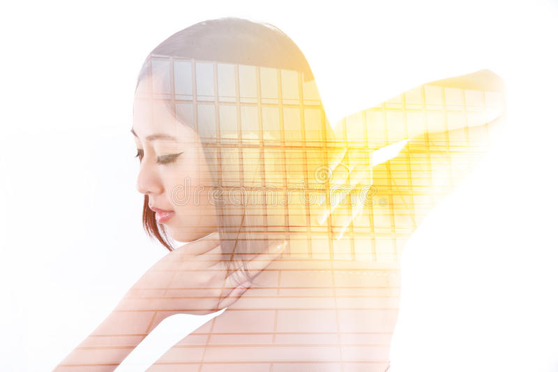 Portrait of Asian woman. Double exposure of lady and building - lifestyle in the city concept royalty free stock photo