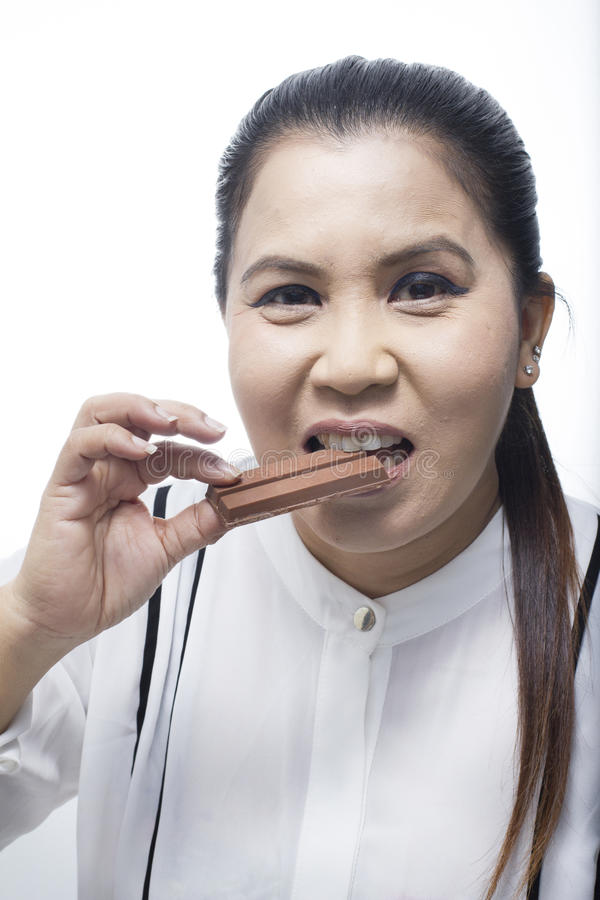 Portrait of Asian woman eating Chocolate royalty free stock photos