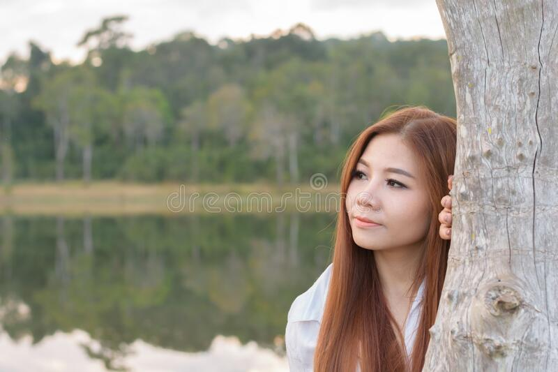 Portrait asian woman. Feelling freshness and relaxing in the forest royalty free stock image