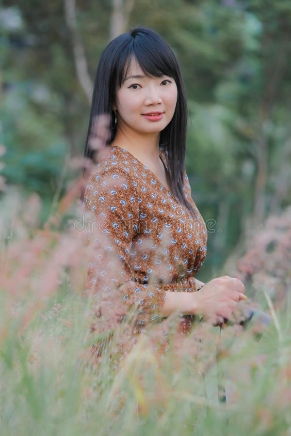 Portrait of Asian woman in garden. Location Bangkok Thailand royalty free stock images