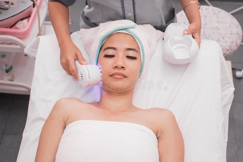 Collagen mask. rf skin tightening machine stock photo