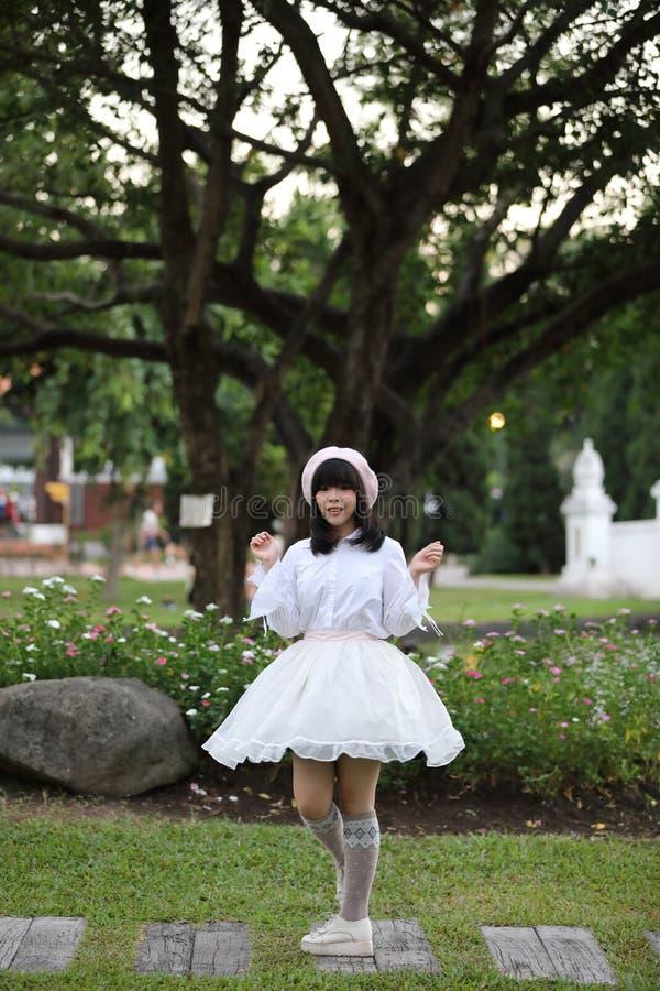 Portrait asian woman lolita dress on nature park royalty free stock images