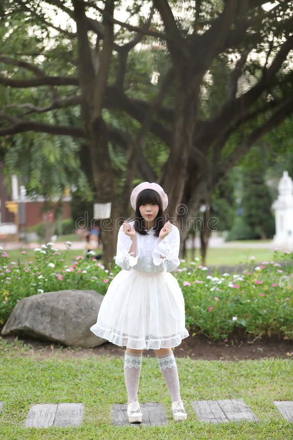 Portrait asian woman lolita dress on nature park stock image