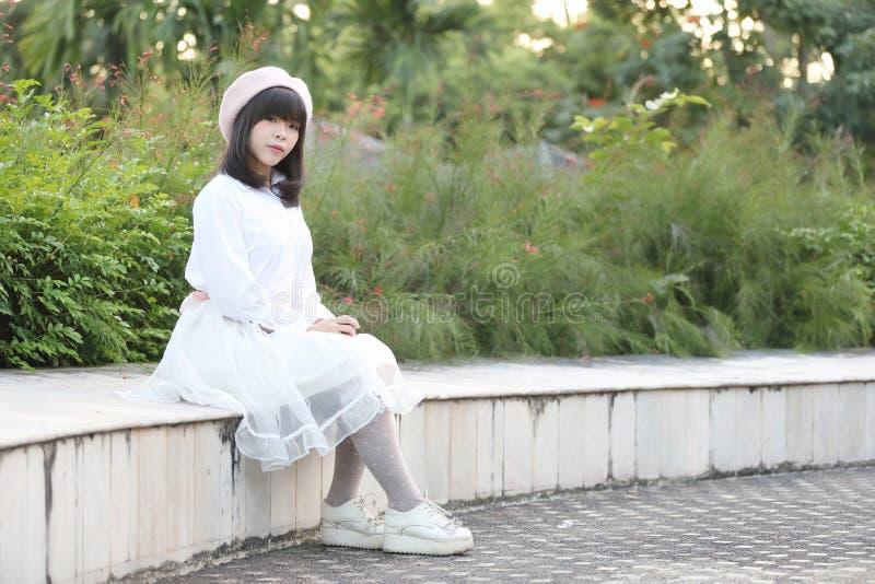 Portrait asian woman lolita dress on nature park royalty free stock image