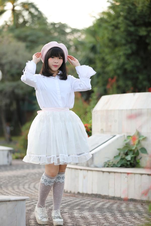 Portrait asian woman lolita dress on nature park royalty free stock photo