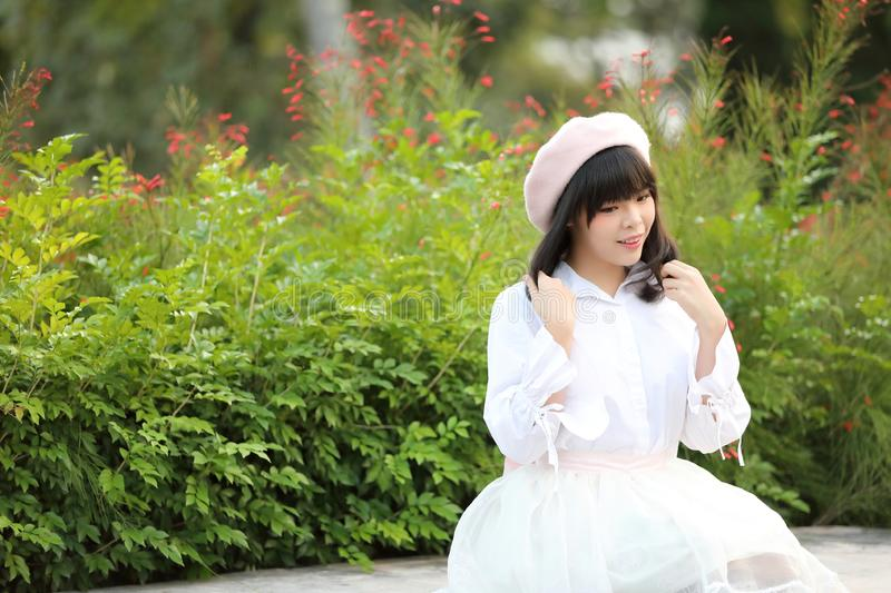 Portrait asian woman lolita dress on nature park stock photos