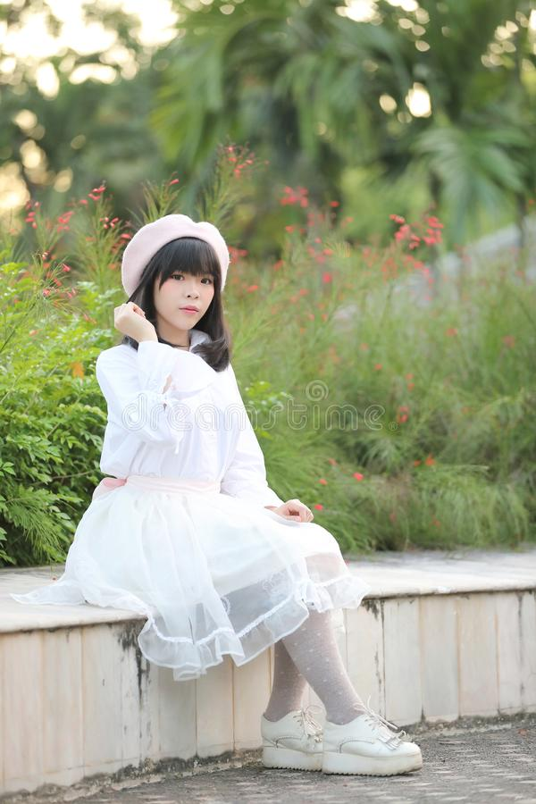 Portrait asian woman lolita dress on nature park royalty free stock photo