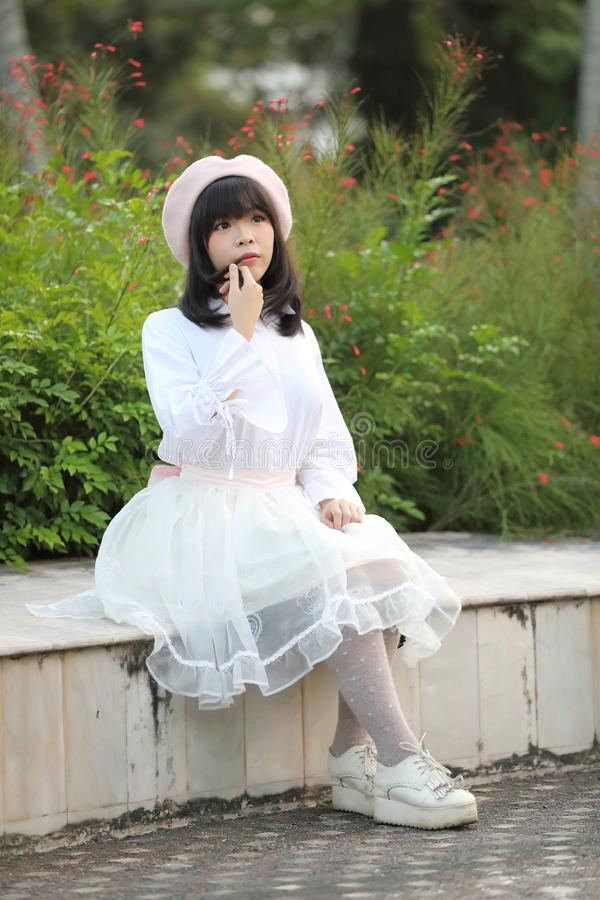 Portrait asian woman lolita dress on nature park stock images