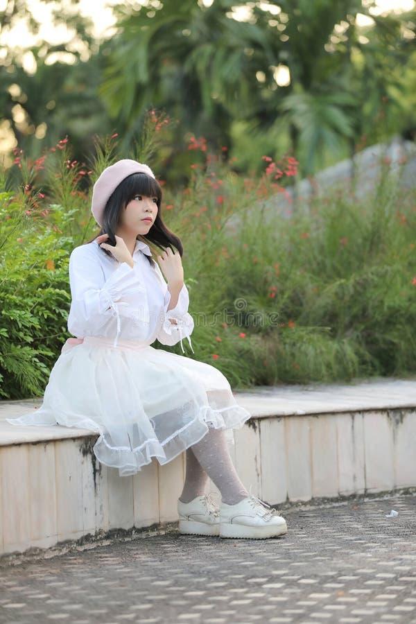 Portrait asian woman lolita dress on nature park stock photo