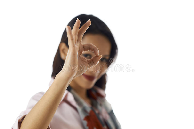 Portrait of asian woman showing ok sign at camera. Young business people, work and positive message, portrait of happy Asian girl doing ok sign with hand stock photo