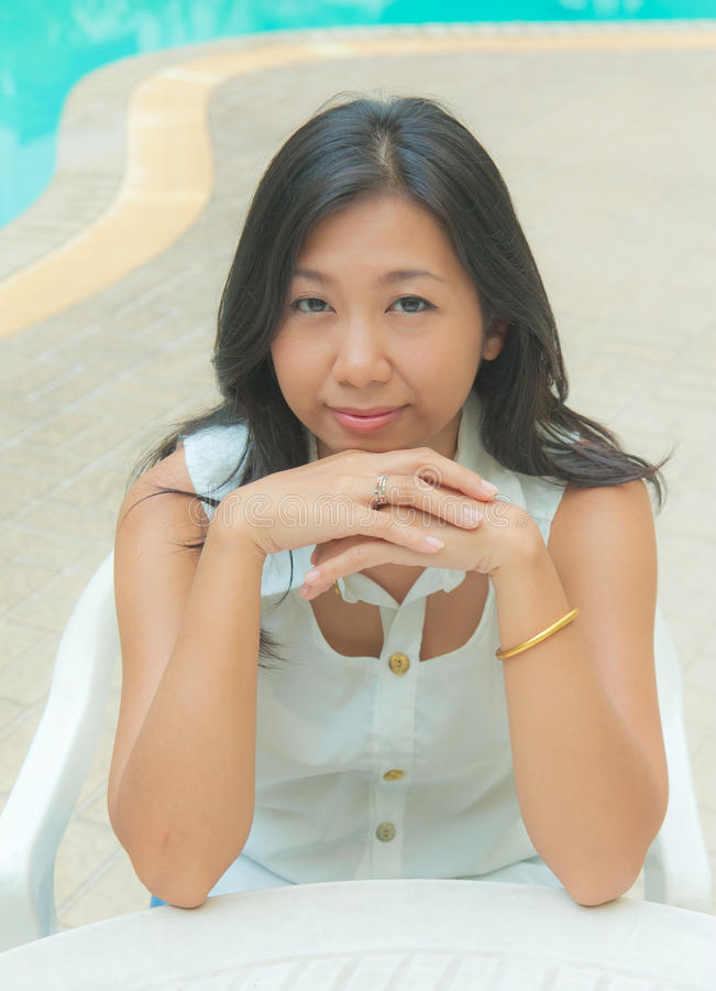 Download Portrait Of An Asian Woman Sitting On A Chair Stock Photo - Image: 33523172
