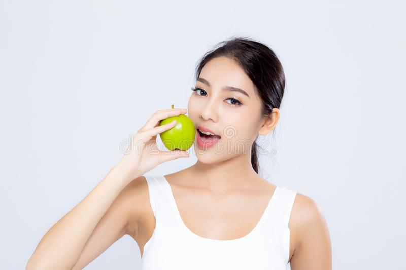 Portrait asian woman smiling holding and eating green apple fruit and beautiful body diet with fit isolated on white. Background, girl weight slim with royalty free stock photos