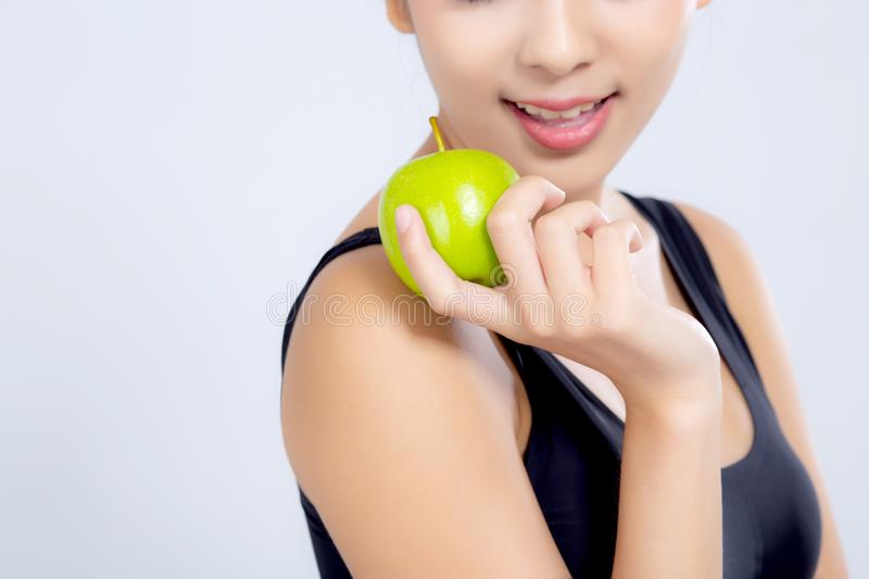 Portrait asian woman smiling holding green apple fruit and beaut. Iful body diet with fit isolated on white background, girl weight slim with cellulite or stock photography