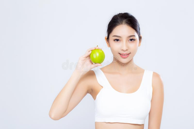 Portrait asian woman smiling holding green apple fruit and beaut. Iful body diet with fit isolated on white background, girl weight slim with cellulite or royalty free stock photos