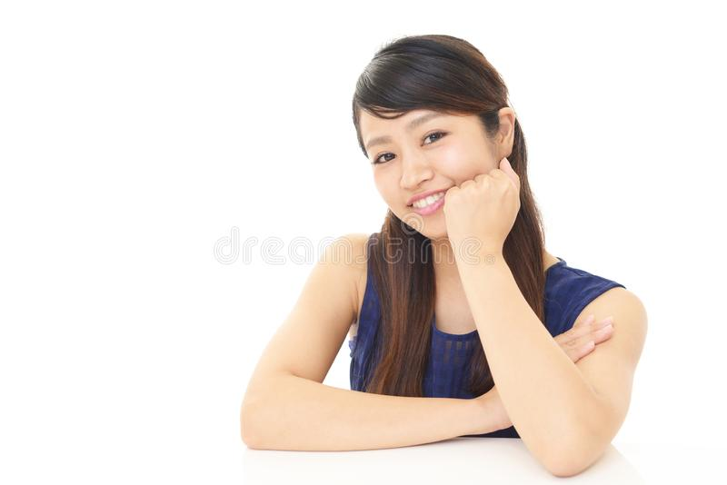 Smiling young woman. Portrait of an Asian woman royalty free stock images
