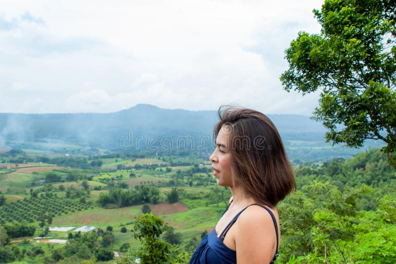 Portrait of Asian women and views of the mountains. stock photo
