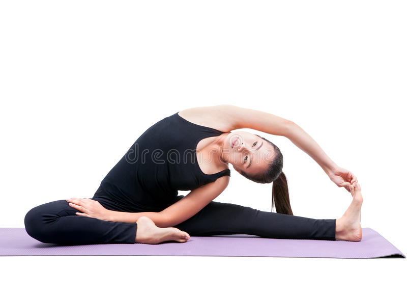 Portrait of asian woman wearing black body suit sitting in yoga. Meditation position isolated white background stock photo
