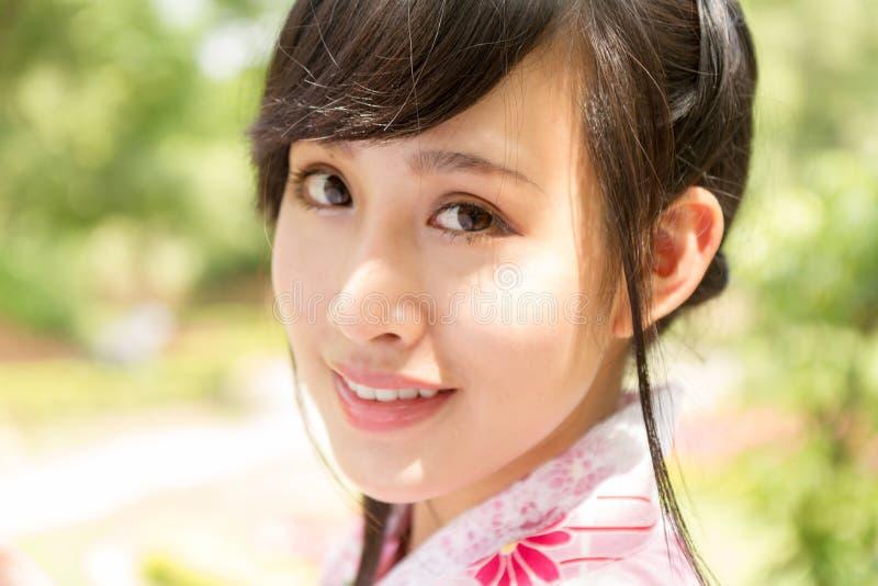 Portrait of an Asian woman wearing a kimono royalty free stock photos