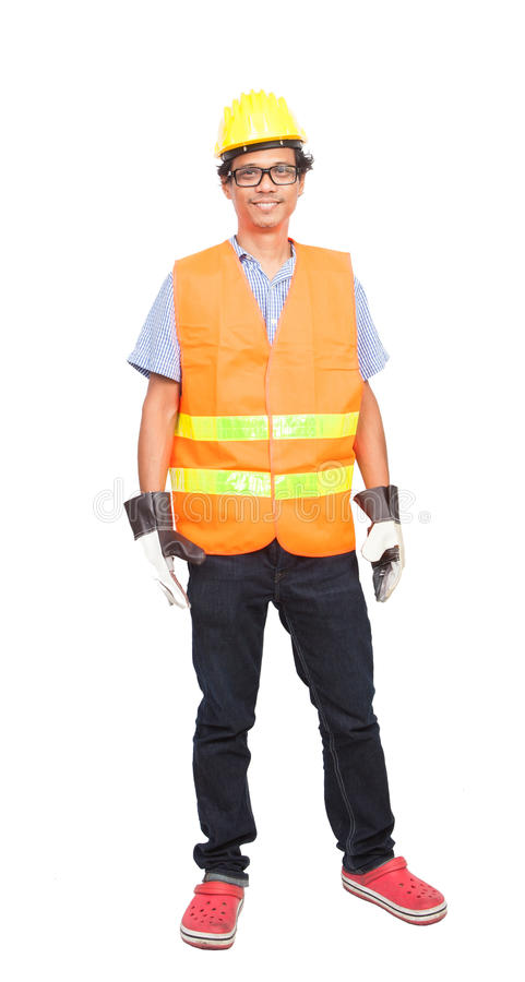 Portrait of asian worker man wearing safety jacket hard hat and royalty free stock photo