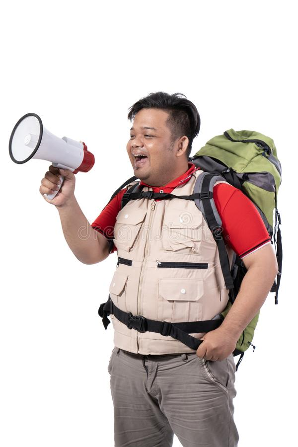 Portrait of asian young backpacker screaming with megaphone stock photos