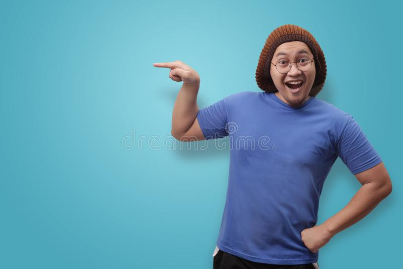 Asian Man Presenting Something on His Side with Copy Space stock photography