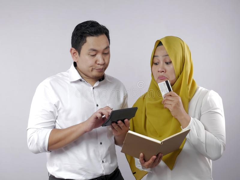 Muslim Couple Analyzing Financial Management Report royalty free stock photo