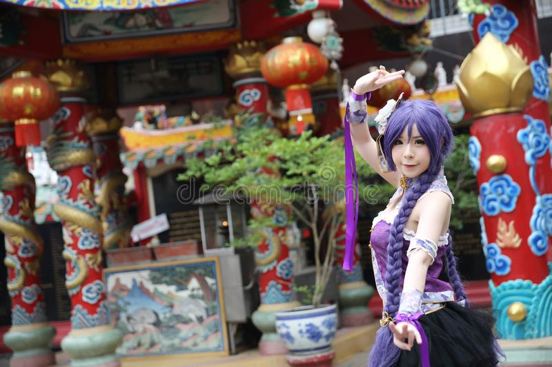 Portrait of asian young woman dancing with purple Chinese dress cosplay with temple. In close up stock image