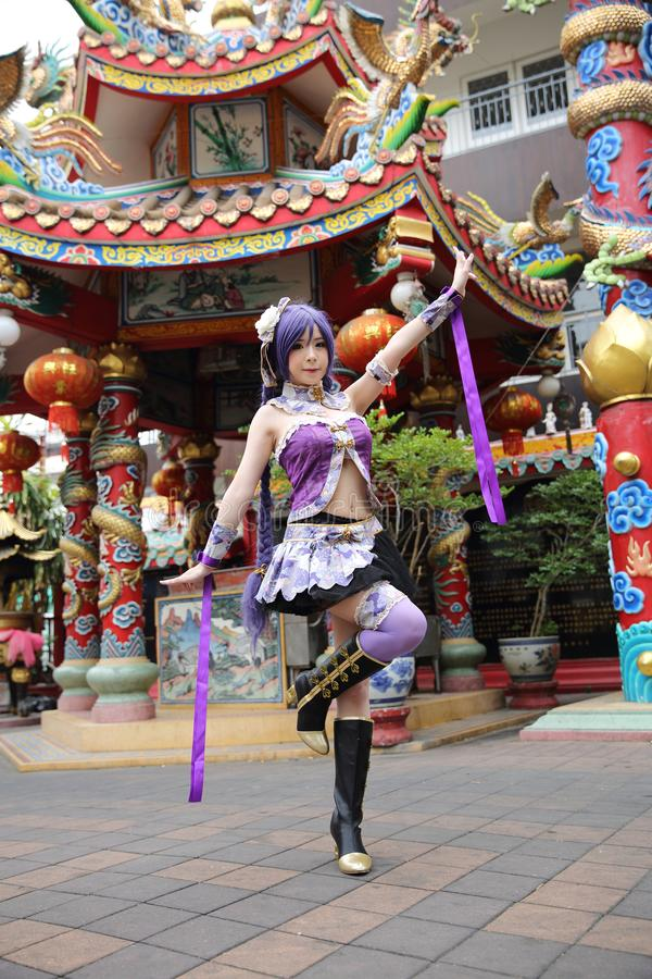 Portrait of asian young woman dancing with purple Chinese dress cosplay with temple. Portrait of asian young woman with purple Chinese dress cosplay with temple royalty free stock photos