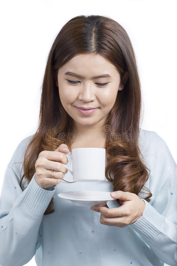 Portrait of Asian young woman drinking coffee royalty free stock photos