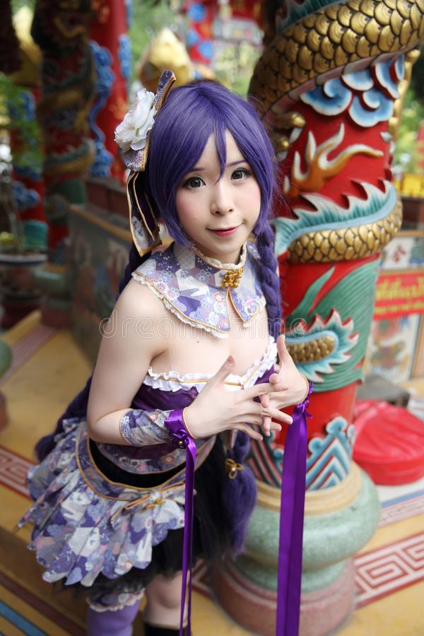 Portrait of asian young woman with purple Chinese dress cosplay with temple. In close up royalty free stock photos