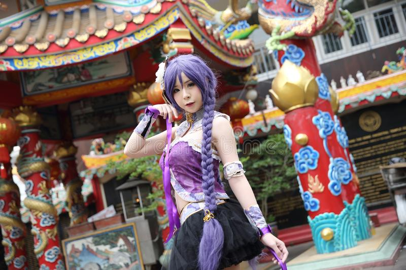 Portrait of asian young woman with purple Chinese dress cosplay with temple. Background stock photo
