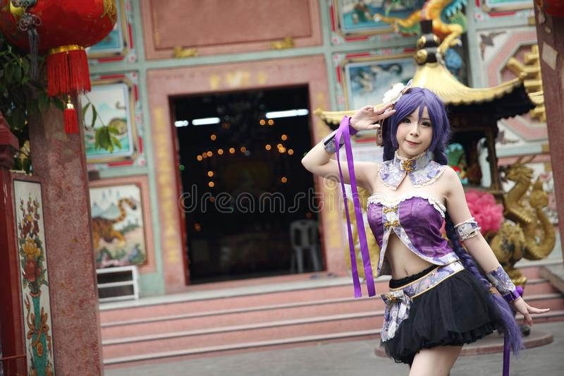 Portrait of asian young woman with purple Chinese dress cosplay with temple. Background stock image