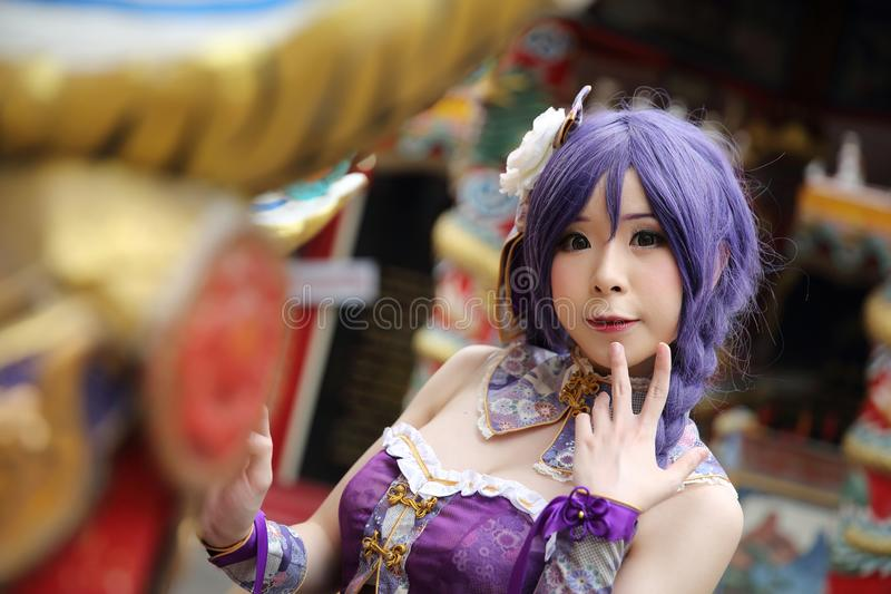 Portrait of asian young woman with purple Chinese dress cosplay with temple. In close up stock image