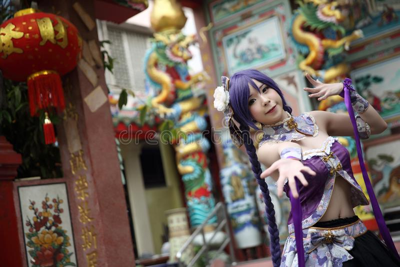 Portrait of asian young woman with purple Chinese dress cosplay with temple. In close up stock photos