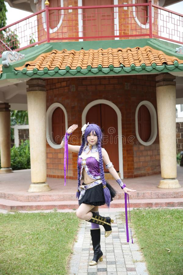 Portrait of asian young woman with purple Chinese dress cosplay with temple. In close up royalty free stock photo