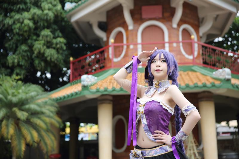 Portrait of asian young woman with purple Chinese dress cosplay with temple. In close up stock photography