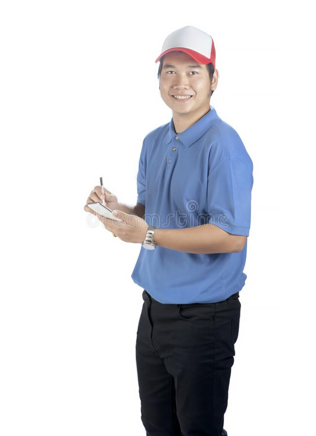 Portrait of asian younger delivery man with smart phone in hand stock photo