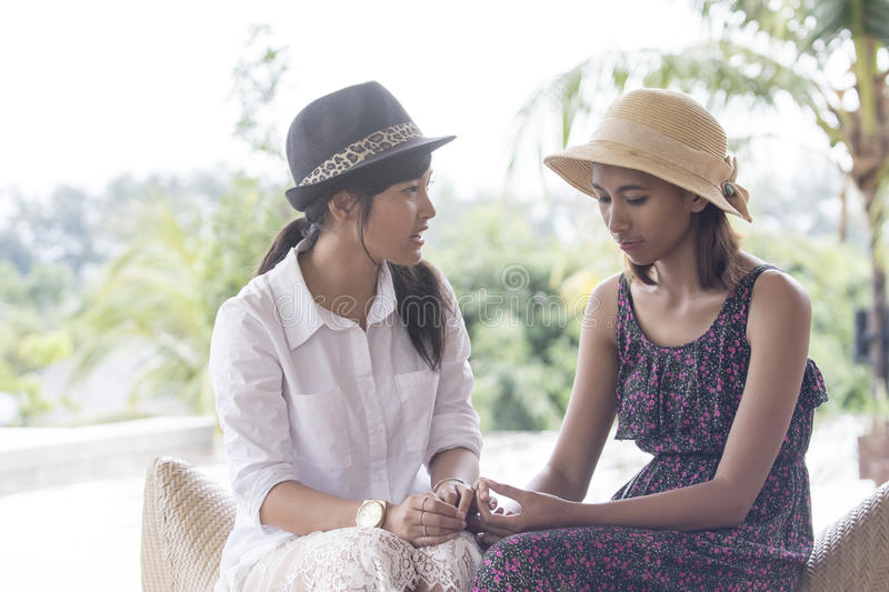 Portrait of asian younger woman friend serious talking stock images
