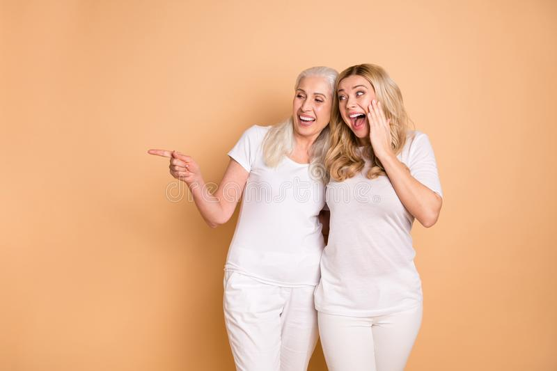 Portrait astonished funny people adults look sales news ads hug embrace decide choose advise select suggest notice. Scream shout dressed trendy stylish clothing stock photography