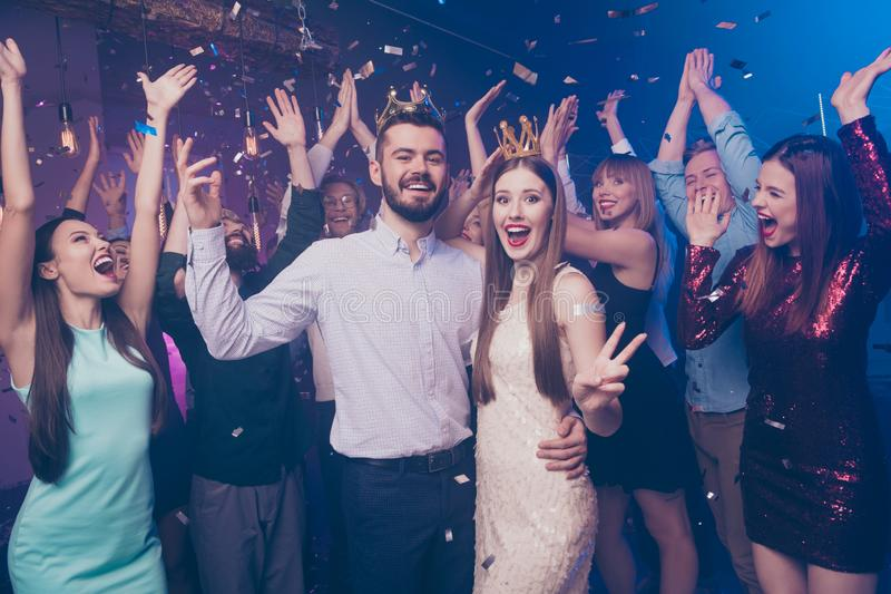 Portrait of astonished people screaming lovers become king queen holiday hug embrace wear dress formal wear suit disco. Portrait of astonished people screaming stock photos