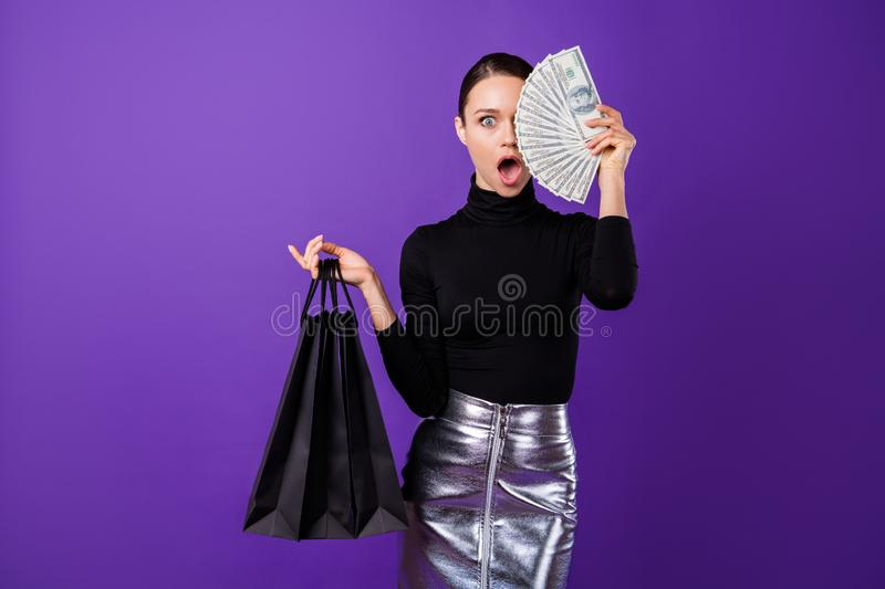 Portrait of astonished person hide her face with finance staring wearing black turtleneck isolated over purple violet. Portrait of astonished, person hide her royalty free stock photos