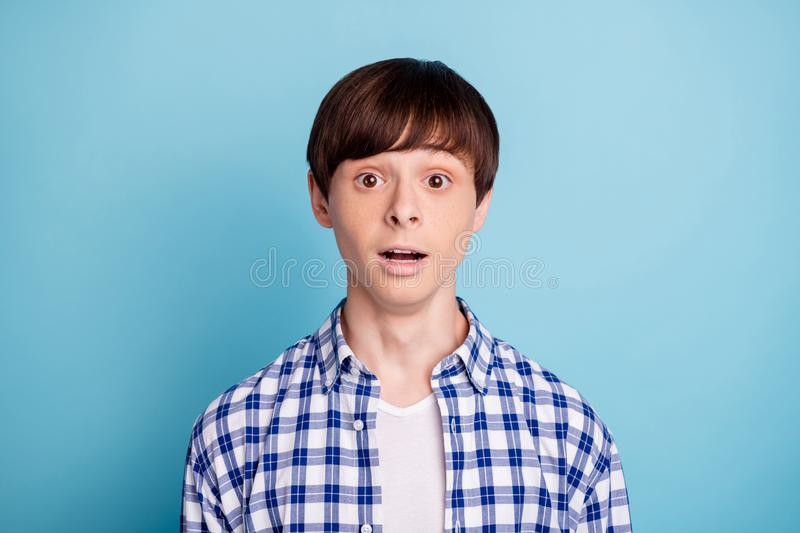 Portrait of astonished person looking wearing checked shirt  over blue background. Portrait of astonished, person looking wearing checked shirt  over blue stock photos
